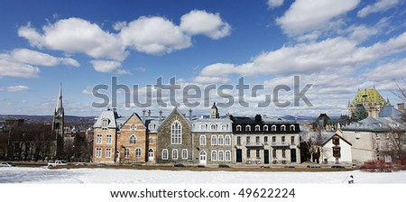 Street in Quebec, Canada, under blue sky with nice clouds - stock photo
