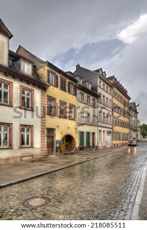 Street in the historic centre of Heidelberg wet from the rain - stock photo