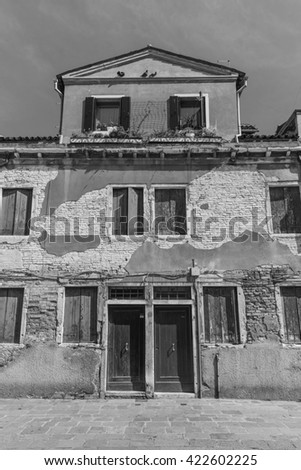 Street in the old town in Venice Italy . Black and white photography.