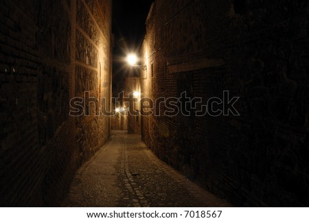 Street in the old town of Toledo at night, Spain