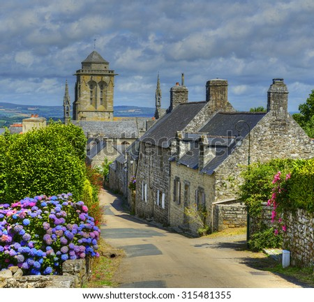 """Street in the village of Locronan, Brittany, France. Locronan is a member of the """"The most beautiful villages of France"""" association. - stock photo"""
