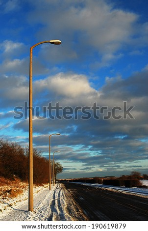 Street in winter and blue sky