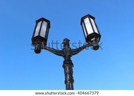 street lamp against a beautiful blue sky