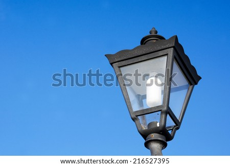 Street lamp against blue sky background. - stock photo
