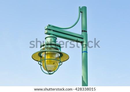 Street lamp against bright blue sky in Burlington, Vermont - stock photo