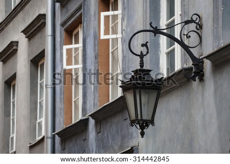Street lamp and Houses in the Old Town of Warsaw, Poland. - stock photo
