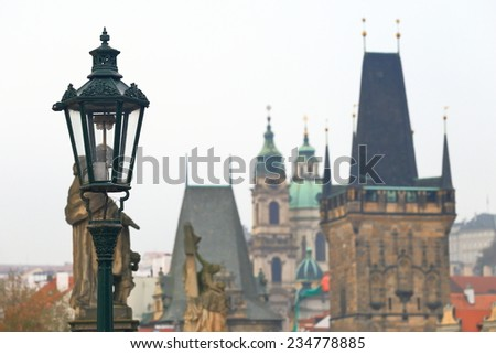 Street lamp from the Charles bridge and distant towers and churches, Prague, Czech Republic - stock photo
