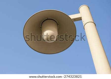 Street lamp in sunny day on a blue sky background - stock photo
