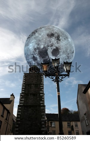 street lamp in the centre of youghal county cork ireland with a full moon