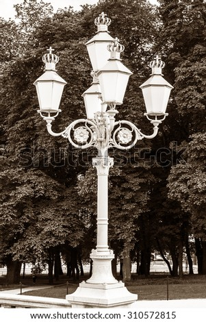 Street lamp in the park in front of the Royal Palace in Oslo, Norway. - stock photo