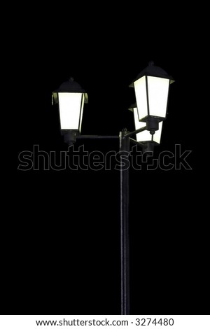 Street lamp in winter with icicle black background isolated