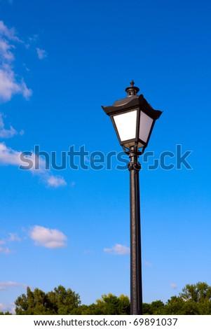 Street lamp on blue sky background - stock photo