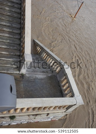 Street Lamp on Murazzi bank of River Po submerged in water due to flood in city centre in Turin, Italy