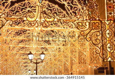 Street lamp on nice background with holiday illumination in night city