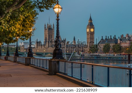 Street Lamp on South Bank of River Thames with Big Ben and Palace of Westminster in Background, London, England, UK - stock photo