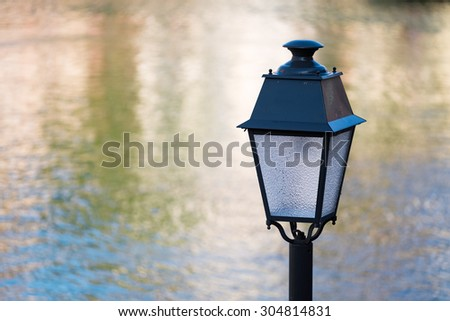 Street lamp on the banks of the river Ill in Strasbourg/France - stock photo