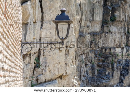 Street Lamp on the Old Brick Wall, Rock Background. Tbilisi. Georgia