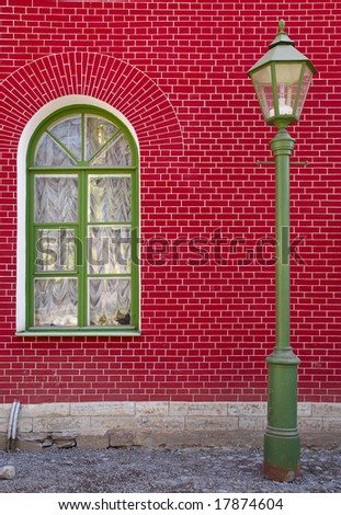 Street lamp on the red wall background - stock photo