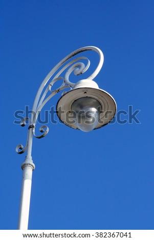 Street lamp. Vintage style street lamp post. - stock photo
