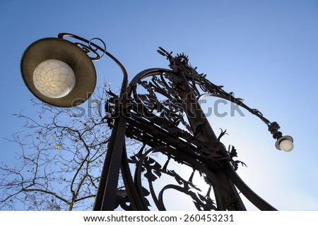 Street lamps in Barcelona against a blue sky. - stock photo