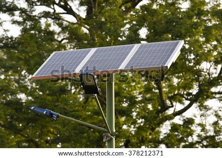 Street Lamps/ lights lit  with Solar Panel in a park in Wayanad, Kerala, India. Solar Lighting on  lush green background. Save energy. source of renewable energy . Energy conservation. save earth. - stock photo
