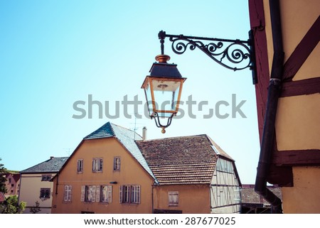 Street lamps on a building wall retro, process color - stock photo