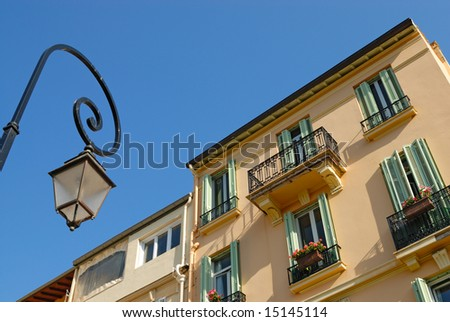 Street lantern in front of residential house - stock photo