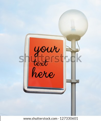 Street lantern with billboard on sky background - stock photo