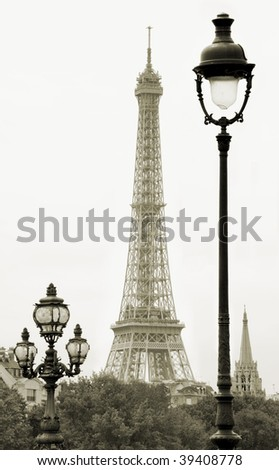 Street lanterns on the Alexandre III Bridge against the Eiffel Tower in Paris, France. - stock photo