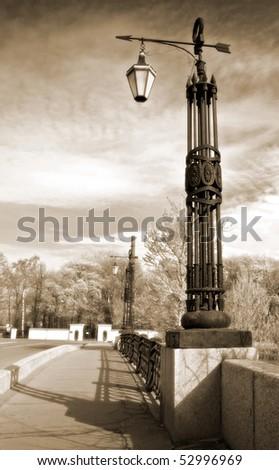 Street lanterns on the bridge in Saint-Petersburg, Russia. Vintage stylized photo. - stock photo