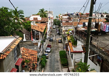 Street leading to Pacific ocean in Puerto Vallarta, Mexico - stock photo