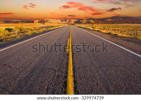 Street-level view of a desolate stretch of Highway 84 in northern New Mexico - stock photo