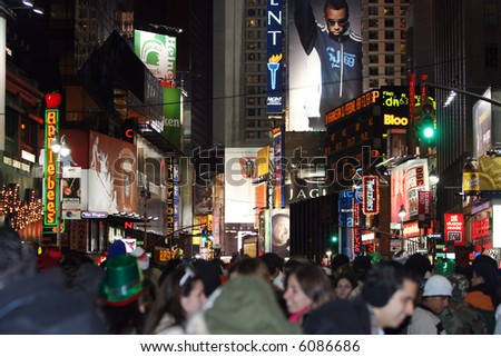 Street level view of New Years festivities at Times Square. [focus is on signs].