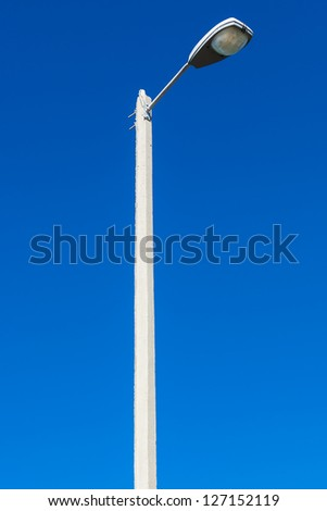 street light against the blue sky - stock photo