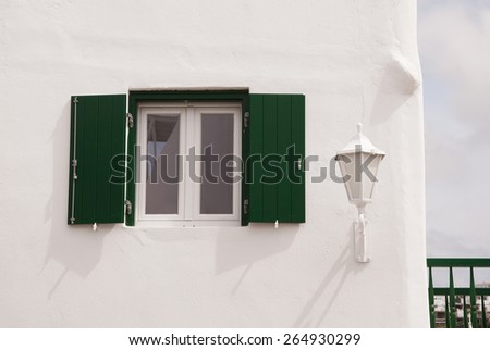 street light and window to the white building - typical of the architecture of Greece. - stock photo