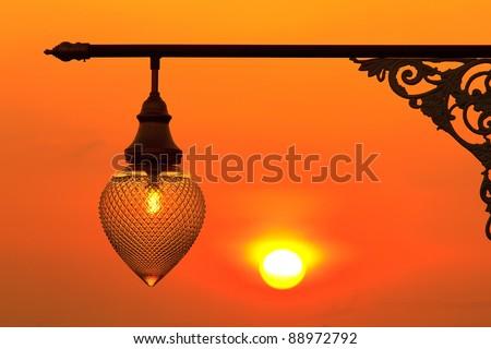Street light at sunset - stock photo