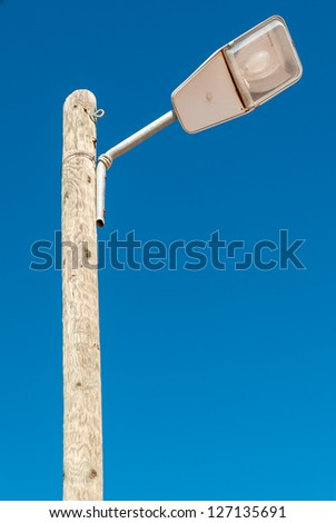 Street light isolated against a blue sky background