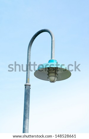 street light lamp post or lantern on a blue sky background