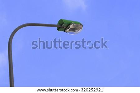 Street light. Street lamp on blue sky and white cloud - stock photo