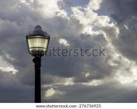 Street light with soft yellow glow before sunset, September in Door County, Wisconsin, USA - stock photo