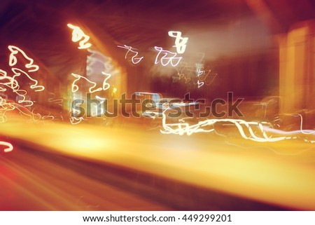 Street lights in speeding car, light motion with slow speed shutter - stock photo