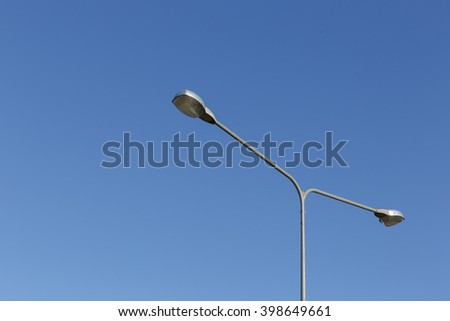 Street lights (Lamp) on the road with blue sky - stock photo