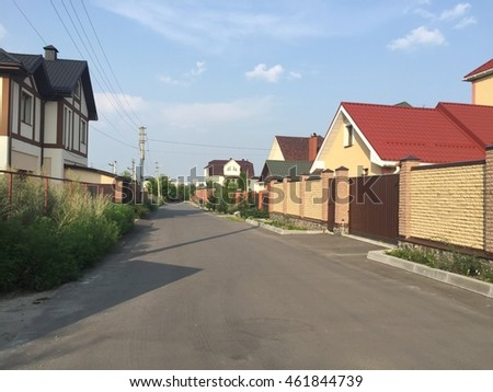Street lined with brick fenced houses