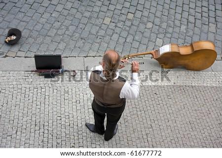Street musician located in Prague, Czech Republic - stock photo