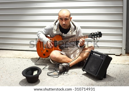 Street musician playing his guitar.