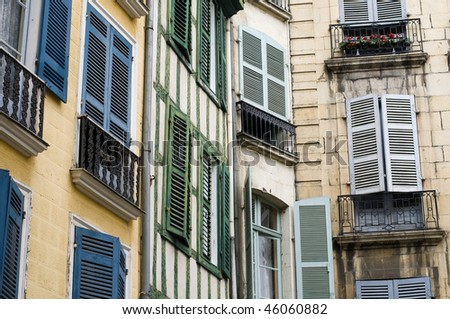 Street of Bayonne, France. Typical French Faded Window Blinds - stock photo