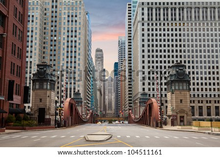 Street of Chicago. Image of street in Chicago downtown at sunrise. - stock photo