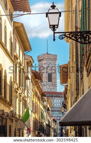 Street of Florence with the tower of  Santa Maria Del Fiore in the back (Tuscany, Italy) - stock photo
