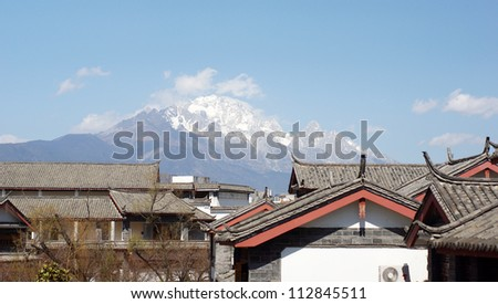 street of lijiang old town under the snow mountain Jade Dragon Snow Mountain , the world heritage site of UNESCO,  - stock photo