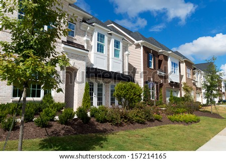 Street of new luxurious  town homes - stock photo